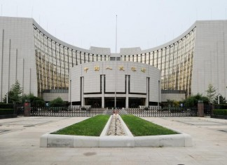 Лицензию на доступ к локальному китайскому рынку облигаций представителям ВТБ вручили в ходе официальной церемонии в здании Народного банка Китая (на фото).